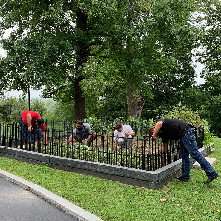 Employees working on the Mansion's garden